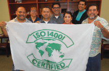 Proudly displaying ISO 14001 banner are these Rangers employees: FRONT– L to R: Ernie Rogers, Ricardo Lamas, Johanna Lamaz, Robert Rogers. BACK– L to R: Adriana Garcia, Tony Hernandez, Josue Alvarez